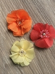 Small beaded flower. Felt backed. x1